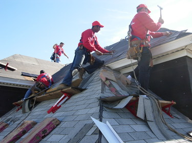 roofers at work at East Boston